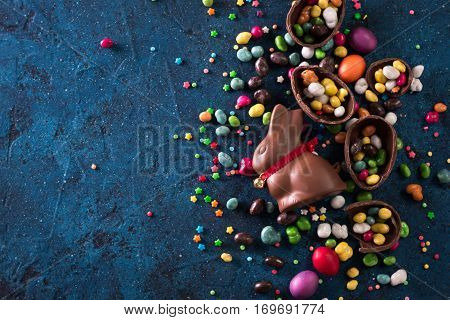 Delicious Chocolate Easter Eggs ,bunny And Sweets On Dark Blue Background