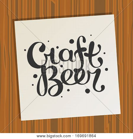 Hand drawn handmade monochrome lettering beer badge on paper and wood background. Beer glass. Logo template and design element for bar, pub, menu, store, beer house, brew company, restaurant.