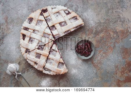 Delicious cranberry pie with lattice top and  jellied fresh cranberries. Top view, vintage toned image, blank space