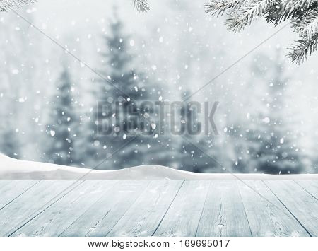 Merry Cristmas and happy New Year greeting background with table .Winter landscape with snow and Christmas trees