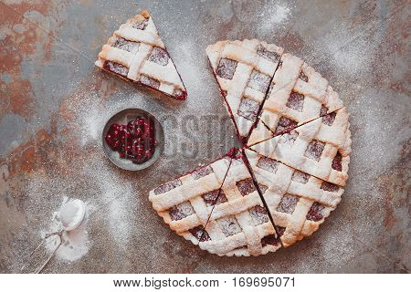 Homemade cranberry pie with lattice. Top view, blank space, vintage toned image