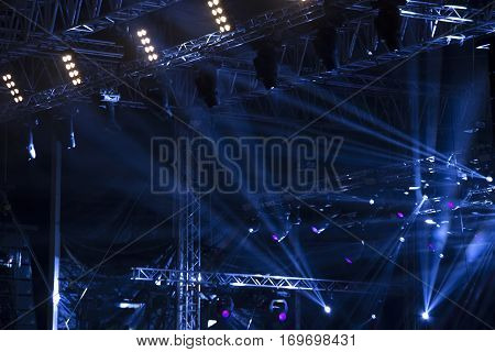 Blue stage lights with the laser rays