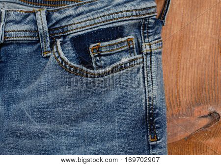 blue jeans on wooden.board