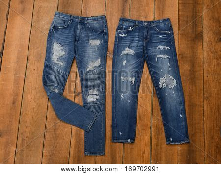 Two jeans trouser on wooden background