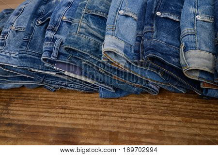 jeans trouser on wooden background