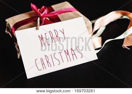Beautiful Simple Present In Craft Paper With Various Ribbons And A Greeting Card, Merry Christmas Te