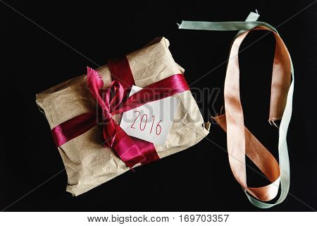 Beautiful Simple Present In Craft Paper With Various Ribbons And A Greeting Card, 2016 Text