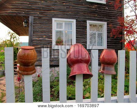 Clay pots on the fence near the village house.