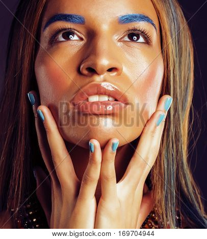young african american woman with creative make up like ethiopian jewelry closeup