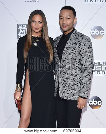 LOS ANGELES - NOV 20:  John Legend and Chrissy Teigen arrives to the American Music Awards 2016 on November 20, 2016 in Hollywood, CA