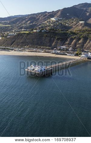 Aerial of historic Malibu pier near Los Angeles in Southern California.