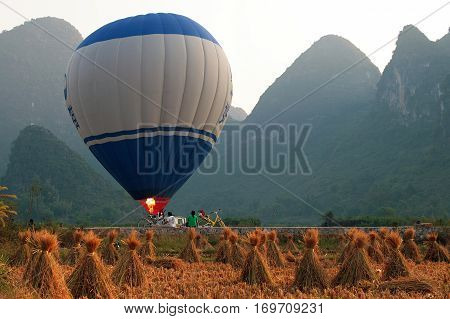 Hot air balloon among the hills and rice fields Yangshuo Guangxi province of China