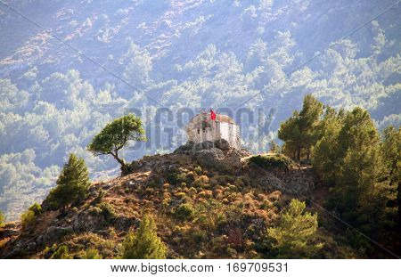 Ruins Of Ancient Church On Top Of The Hill In Ghost Town Of Kayakoy (turkey)