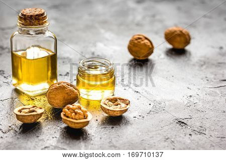 cosmetic and therapeutic walnut oil on dark background.
