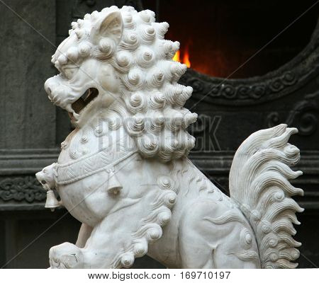 Traditional chinese guardian lion in the temple