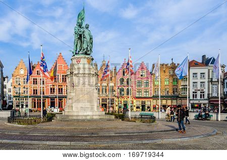 BRUGES, BELGIUM - JANUARY 27, 2017: Colorful old brick houses in the Market Square in the UNESCO World Heritage Old Town of Bruges Belgium