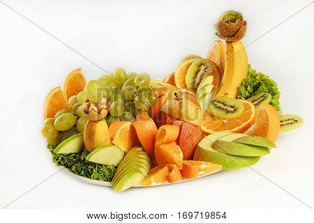fresh tropical fruits kiwi orange in studio