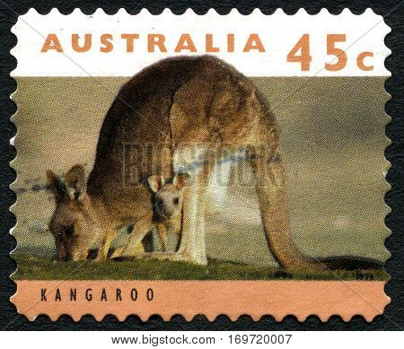AUSTRALIA - CIRCA 1994: A used postage stamp from Australia depicting an image of a Kangroo and Joey in its pouch circa 1994.