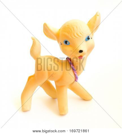 The Miniature yellow toy fawn.