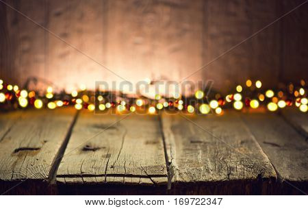 Wooden Table background. Rustic Holiday Background, Shabby Table decorated with garlands. Beautiful Empty Vintage room. New Year Christmas Frame for your text