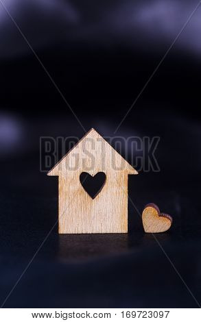 Wooden House With Hole In Form Of Heart On Black Satin Fabric