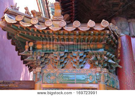 BEIJING - FEBRUARY 23:  An ornate painted roof on a building in the Forbidden City in Beijing, China, February 23, 2016.