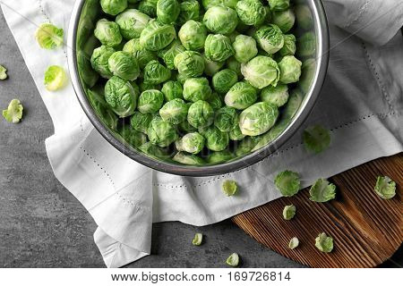 Brussels sprouts in metal bowl on napkin