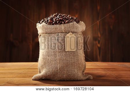 Coffee beans in sackcloth on table