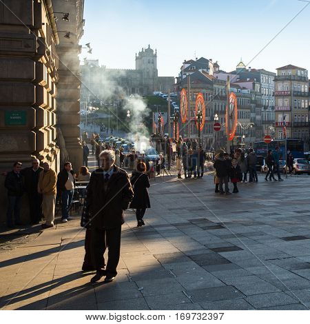 PORTO, PORTUGAL - DEC 26, 2016: One of the streets in the historical centre of Old Porto downtown. City of Porto won the European Best Destination 2012 and 2014 awards.