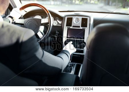 Chauffeur driving a car, view from inside