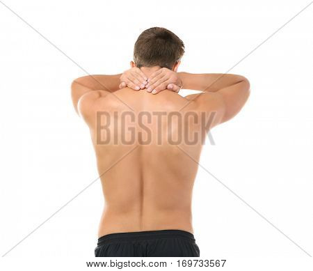 Young man with pain in neck isolated on white