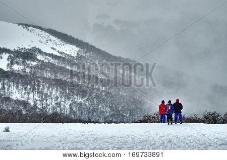 Three People Admiring The Landscape