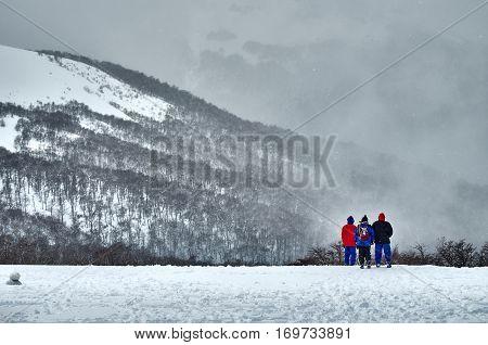 Three People Admiring The Landscape