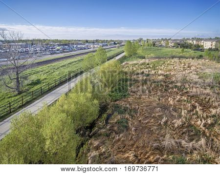 aerial view of a bike trail, railroad and green areas in Fort Collins, Colorado, spring scenery