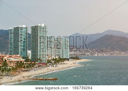Puerto vallarta port in Mexico. Coastline of Mexico resort with modern hotels. Panorama of tropical resort