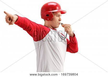 Baseball coach blowing a whistle and pointing with his hand isolated on white background
