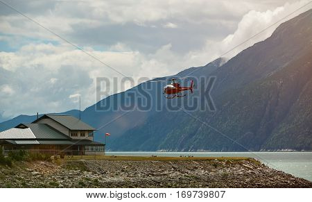 Helicopter tour in Alaska landscape. Tourism helicopter flight in mountains
