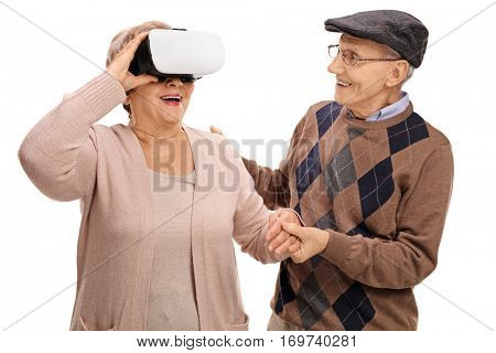 Mature woman using a VR headset with a mature man holding her hand isolated on white background