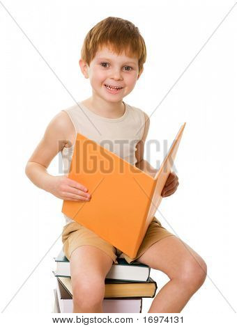 ?dorable young boy with the book