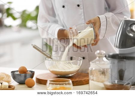 Cooking concept. Professional confectioner making delicious dessert, closeup