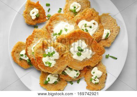 Plate with tasty potato pancakes for Hanukkah on table, closeup