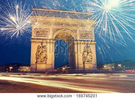 Arch of Triumph with fireworks, celebration of the New Year in Paris, France