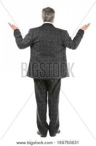 Senior businessman standing back on white background