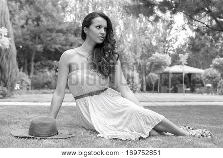 Full length of beautiful young woman in sundress at park