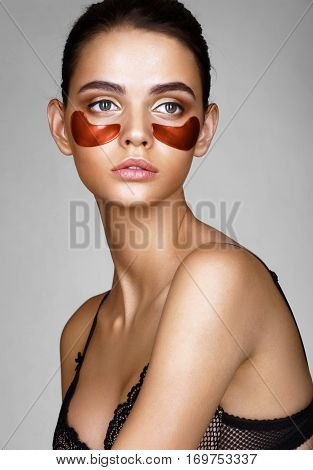 Beautiful lady with red eye patches. Portrait of young woman with perfect skin. Skin care concept.
