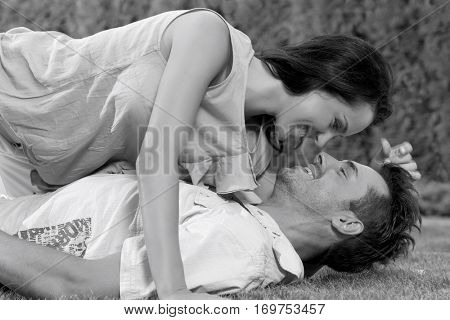 Side view of loving woman lying on man in park