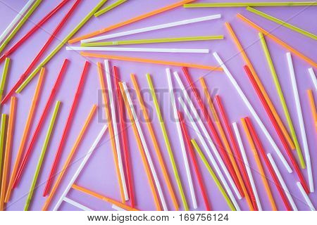 Colorful drinking straws on a pink color background. Abstract a colorful of plastic straws used for drinking water or soft drinks