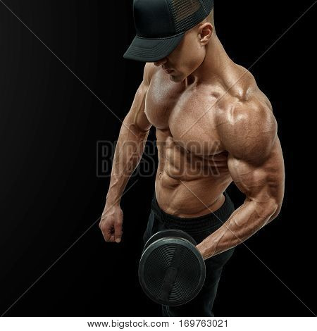 Closeup Of A Handsome Power Athletic Man Bodybuilder Doing Exercises With Dumbbell In Left Hand