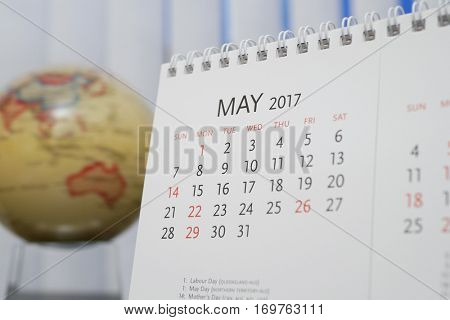 Close up calendar of May 2017 with blur earth globe background