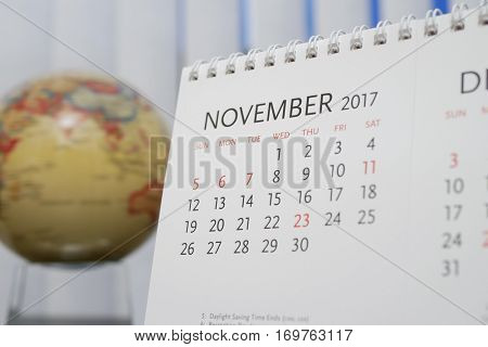 Close up calendar of November 2017 with blur earth globe background